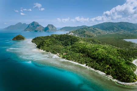 Aerial panoramic view of Palawan amazing coastline, majestic limestone cliffs and sea bay in El Nido, Philippines