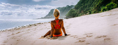 Tanned blonde tourist woman on summer vacation, beach, Bali. Travel wanderlust vacation concept