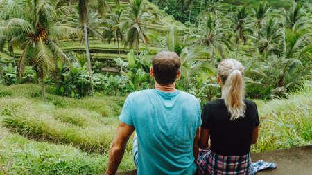 Happy couple explore Tegalalang rice terraces near Ubud, Bali, Indonesia. Summer travel vocation concept Stok Fotoğraf