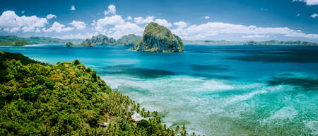 Panoramic aerial view of tropical Palawan island with unique Pinagbuyutan island on horizon. El Nido-Philippines Southeast Asia Bacuit archipelago Stok Fotoğraf