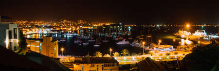 Panoramic night picture of Mindelo city in twilight. Port town with many boats in the lagoon on the Cape Verde, Sao Vicente Island