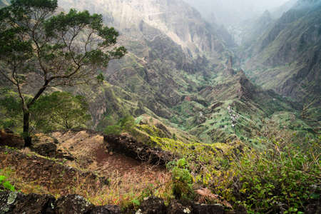 Santo Antao, Cape Verde. Hiking trail path leading between mountains into Xo-Xo valley with scenic impressive landscape Stok Fotoğraf
