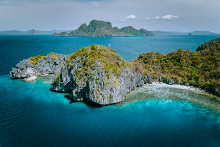 Aerial drone panorama picture of tropical paradise epic limestone Entalula Island. Miniloc island in background. El Nido, Palawan, Philippines