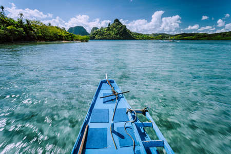 Local banca boat on tour trip to the protected famous Snake Island El Nido, attractions tourist locations Palawan in the Philippines