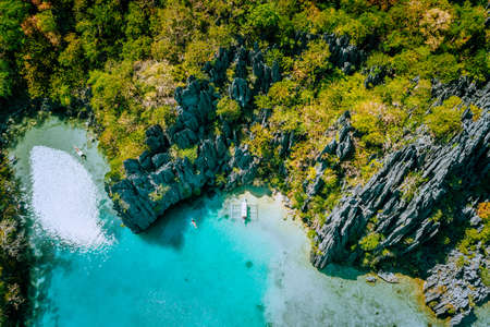 Marine Reserve El Nido Palawan Philippines, aerial view of tropical paradise turquoise lagoon and sharp limestone cliffs