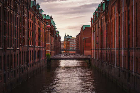 Speicherstadt warehouse district in Hamburg, Germany. Old brick buildings and channel of Hafencity quarter.