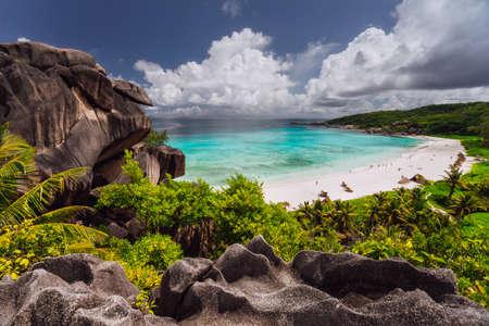 Grand Anse beach with Rainy clouds. La Digue island, Seychelles