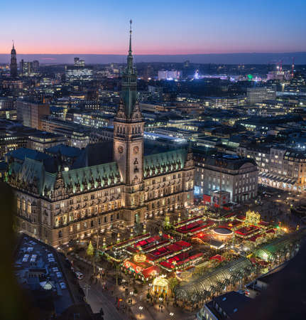 Top view of illuminated Christmas market on townhall square in advent time, Hamburg, Germany Stock Photo