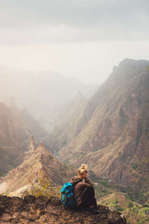 Santo Antao Island Cape Verde. Female tourist enjoying breathtaking view of impressive Ribeira da Torre valley surrounded by towering mountain tops.