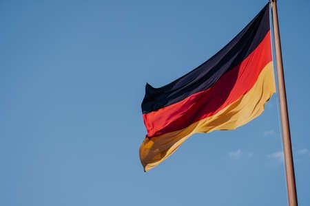German national flag on blue sky background.