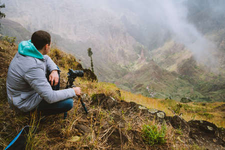 Santo Antao Island, Cape Verde. Hiking outdoor activity in ribeira da torre. Male traveler photographing surreal Xo Xo valley
