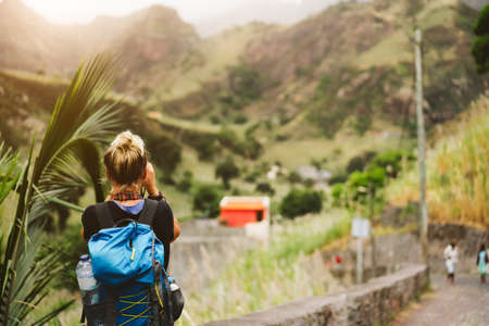 Santo Antao Island Cape Verde. Female tourist with backpack photographing scene of Paul valley