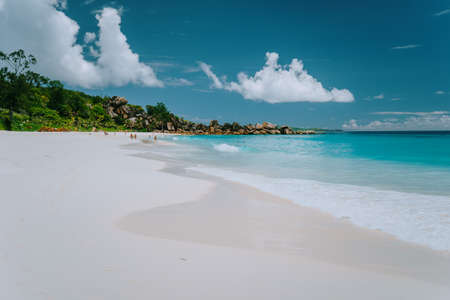 Grande Anse beach at La Digue island, Seychelles. White sand, turquoise lagoon and blue sky.