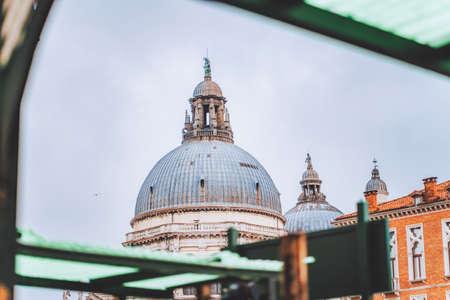 Venice, Italy. Frame of cupel of Basilica di Santa Maria Della Salute against moody sky 版權商用圖片