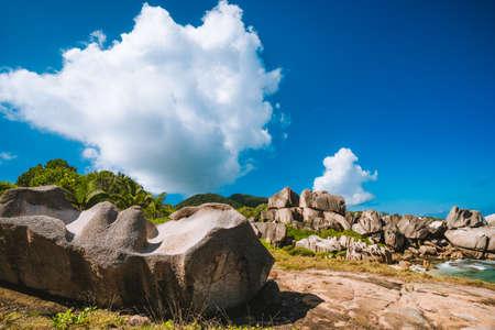 Granite rocks at Grand L Anse remote beach, La Digue, Seychelles. Holiday vacation travel concept.