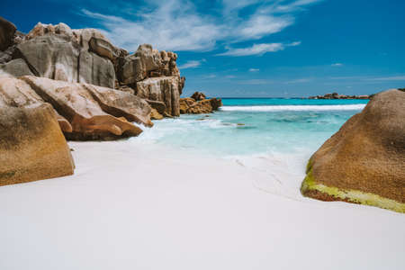 Anse Cocos, La Digue island, Seychelles. Tropical lagoon with granite boulders in the turquoise water and a pristine white sand.