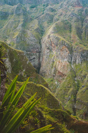 Santo Antao, Cape Verde. Breathtaking view of canyon with steep cliff and winding riverbed with lush green vegetation.