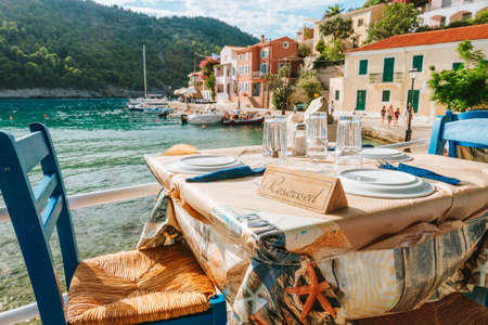 Reserved table in Greek tavern in Assos fishing village, Kefalonia island, Greece.