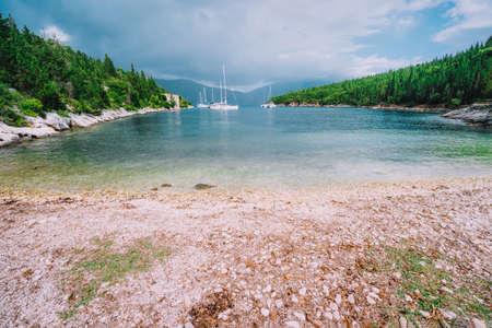 Foki Fiskardo Beach Kefalonia, Ionian islands, Greece. Sea bay with private white yacht in the lagoon. Stok Fotoğraf