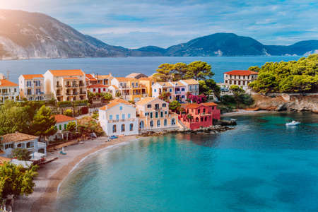 Cozy colorful town Assos with red roofs at the lush green Mediterranean place of Kefalonia Island, Greece. Stock Photo