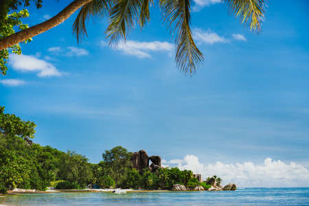 La Digue Island, Seychelles island. World famous tropical beach Anse Source dArgent. Shape of palm leaves and ocean lagoon