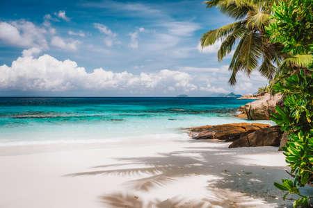 Holiday vacation visiting exotic tropical sandy beach on Mahe Island, Seychelles. Exotic travel destination in season.