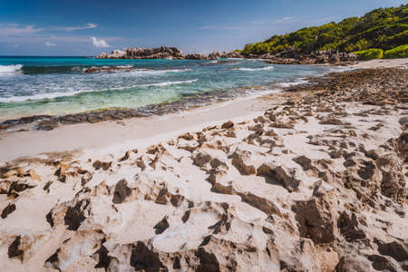 Rough sharp old coral coastline on remote beach with granite rocks, Grand L Anse, La Digue, Seychelles