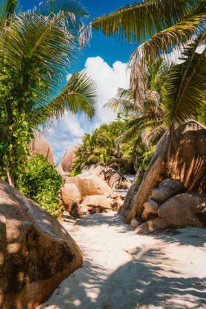 Beautiful beach foot path trail at Seychelles, La Digue, Anse Source d'Argent.