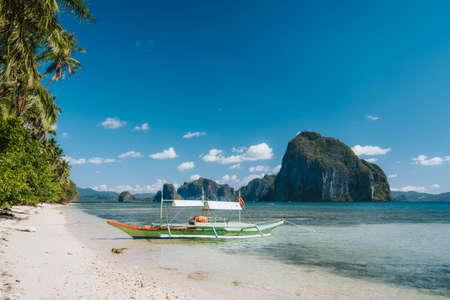 Tourism island hopping boat near Las sandy Cabanas beach, El Nido, Palawan, Philippines