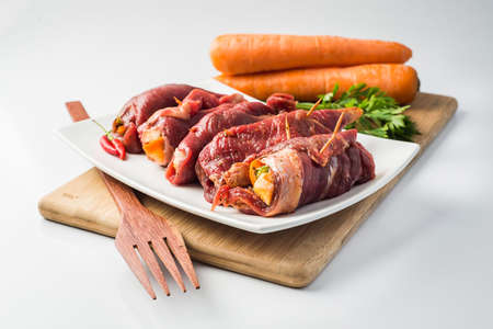 Steak a turtleneck, stuffed meat with vegetables, carrots and parsley