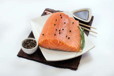 fishmonger: Salmon with pepper and soy sauce on the plate