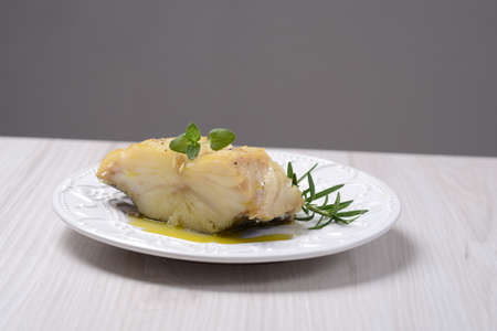codfish: Baked cod recipe on the plate, codfish Stock Photo