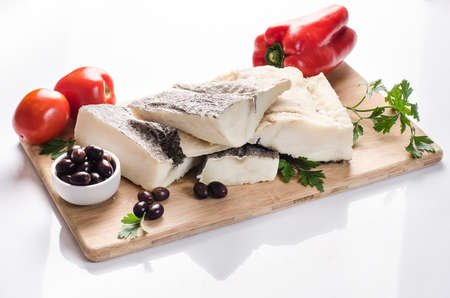 codfish: dried salted cod, Codfish with black olives, tomatoes and pepper