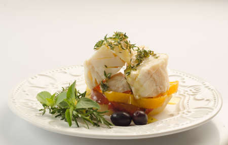 codfish: Baked cod with rosemary, pepper and black olives, codfish Stock Photo