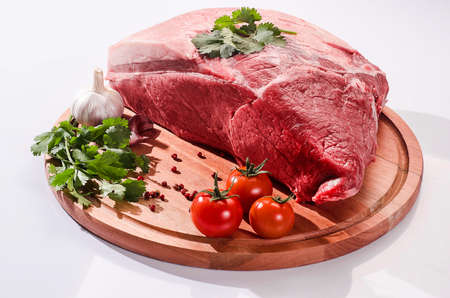 piece of meat on the wooden board