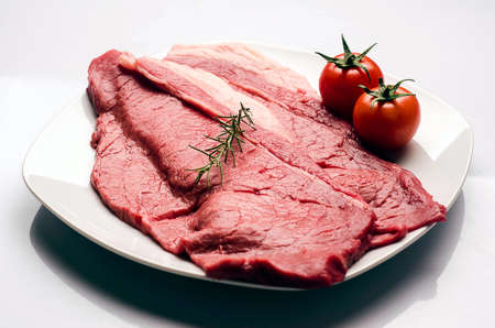steak meat with tomatoes and rosemary
