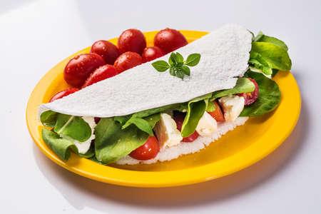 Salt tapioca with arugula, cheese and tomatoes