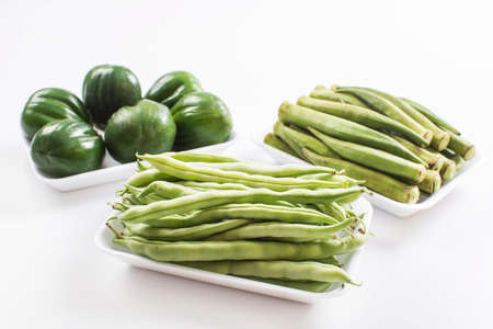 haricot vert: scarlet eggplant, okra and haricot vert, string beans, french beans Stock Photo