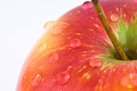 macro red apple with water drops photo
