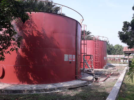 two brownish red oil fuel tanks