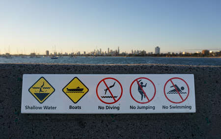 Various Signs to Obey at a Beach in Australia 版權商用圖片
