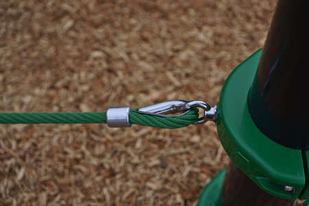 Green ropes with a metal hook fastener
