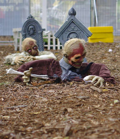 Two zombies coming out of cemetery ground