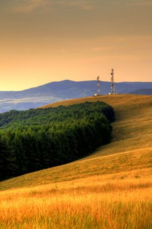 hdr image of romanian hills with towers on the background