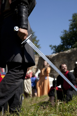 young knight preparing to atack another man on the batlefield Stock Photo - 10544016