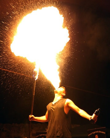 bare chested: fire breather making a huge flame in a show in romania