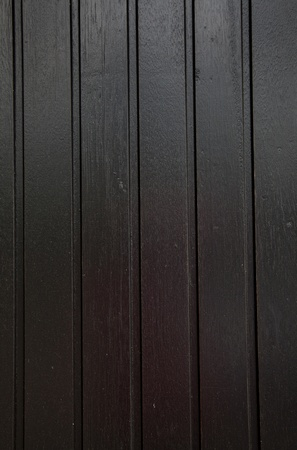 black wood background with straight vertical lines