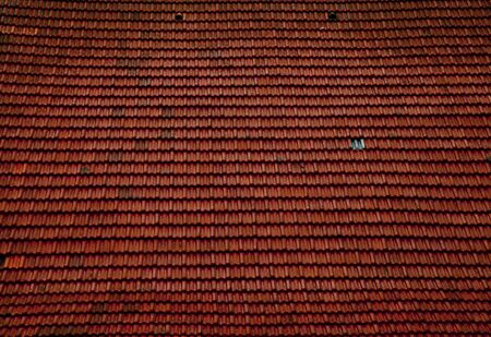 roof shingles: red tile background with many pieces of ceramic material