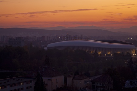 the city pf cluj napoca romania at sunset with the cluj arena football stadium on the background Stock Photo - 11091888