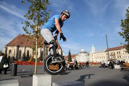 young man jumping with a monocycle